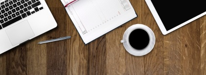 digital tablet pc, computer and cup of coffee on wooden table